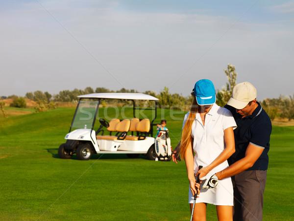 çift oynama golf golf sahası genç aile Stok fotoğraf © dashapetrenko
