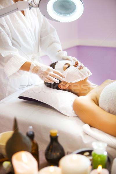 Beautiful woman getting a facial treatment at the health spa Stock photo © dashapetrenko