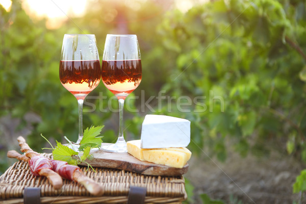 Two glasses of rose wine with bread, meat, grape and cheese  Stock photo © dashapetrenko