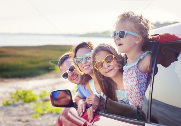 Portrait of a smiling family with two children at beach in the c Stock photo © dashapetrenko
