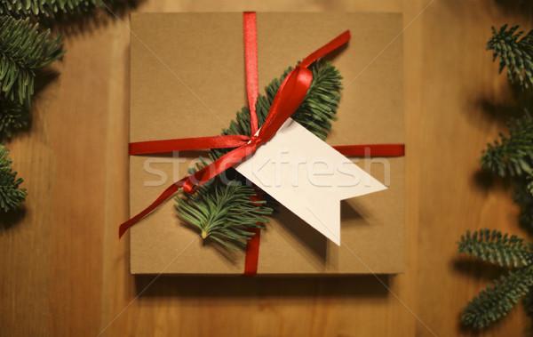 Christmas gift laid on a wooden table background Stock photo © dashapetrenko