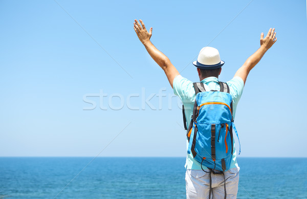 Happy man raised arms on beach Travel and vacarion concept Stock photo © dashapetrenko