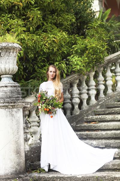 Beautiful happy bride wuth bouquet outdoors Stock photo © dashapetrenko