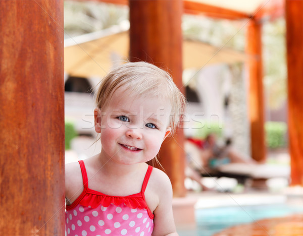 Little cute baby girl in swimming pool Stock photo © dashapetrenko