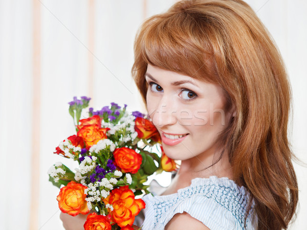 Happy young woman holding bid bouquet of flowers  Stock photo © dashapetrenko