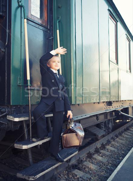 little boy with a suitcase in the retro train Stock photo © dashapetrenko