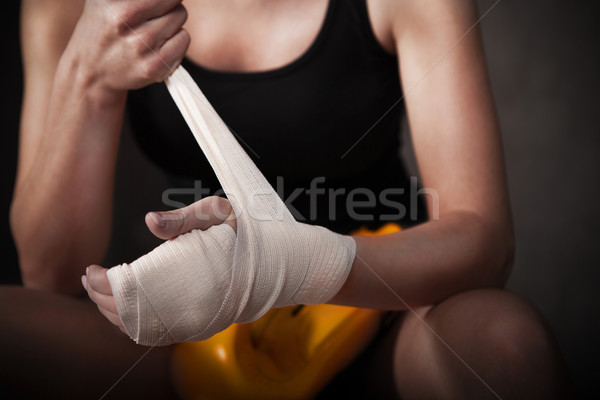 Female boxer wearing white strap on wrist Stock photo © dashapetrenko