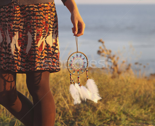 Brunette woman with long hair holding dream catcher  Stock photo © dashapetrenko