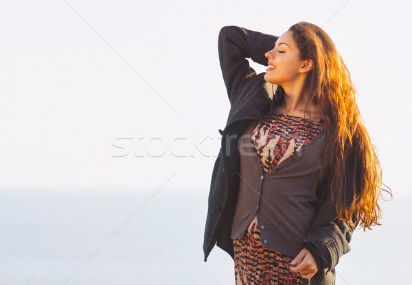 Portrait of the beautiful brunette woman at the windy autumn day Stock photo © dashapetrenko