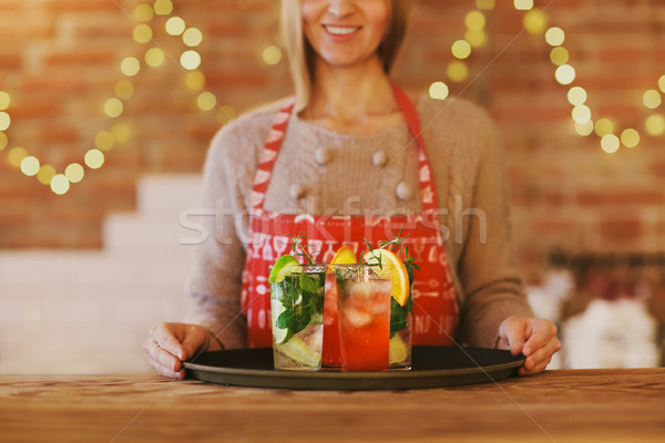 Young pretty woman with red and green cocktails on tray Stock photo © dashapetrenko