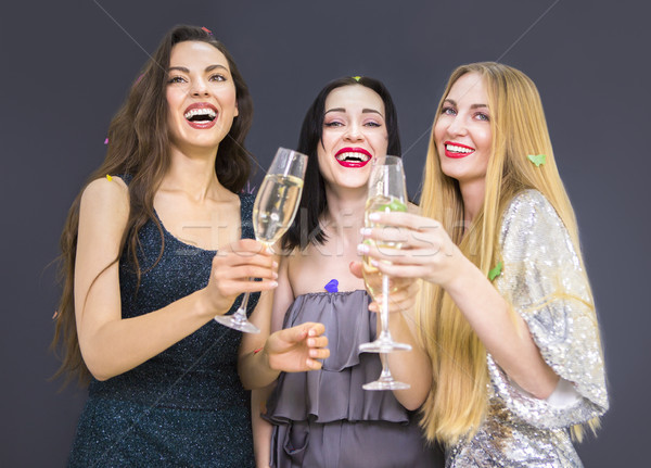 Three young woman having fun with champagne Stock photo © dashapetrenko