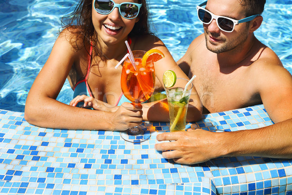 Young couple are relaxing at swimming pool Stock photo © dashapetrenko