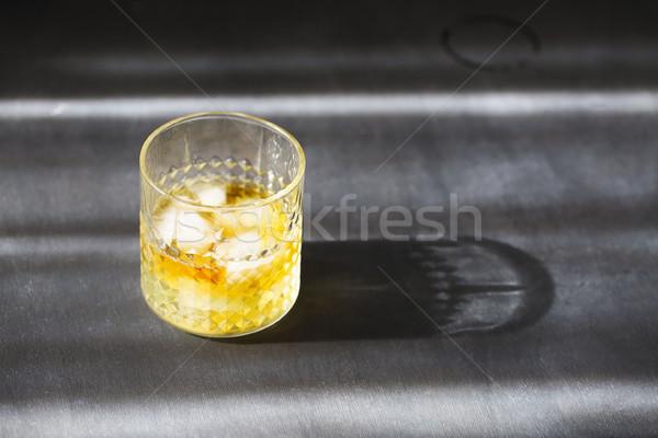 Glass of whiskey on dark background. Close up Stock photo © dashapetrenko