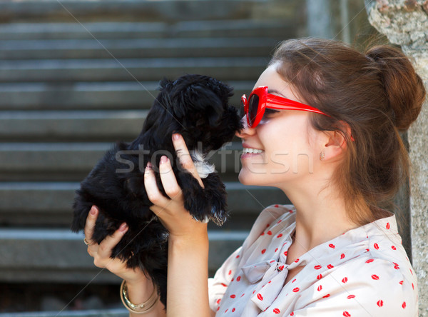 Young brunette woman hugging her lap dog puppy Stock photo © dashapetrenko