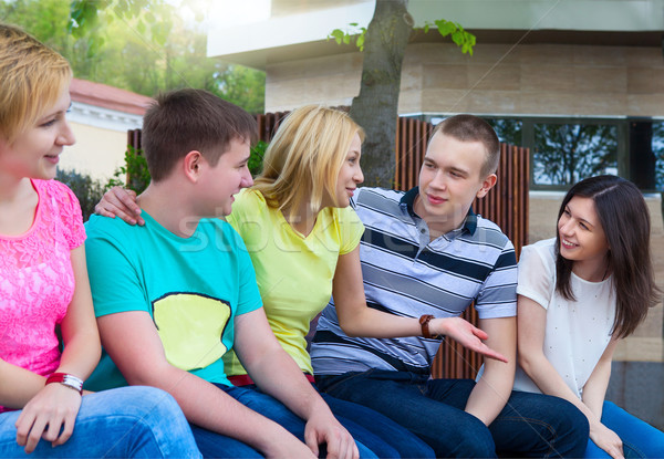 Group of smiling teenagers outdoors Stock photo © dashapetrenko