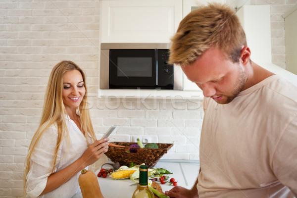 Portrait of happy young couple at the kitchen  Stock photo © dashapetrenko