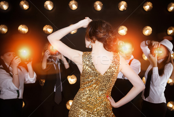Superstar woman posing to paparazzi Stock photo © dashapetrenko