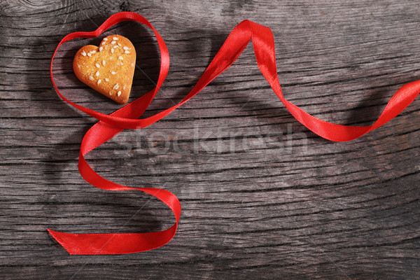 One cookies and heart shaped red ribbon Stock photo © dashapetrenko