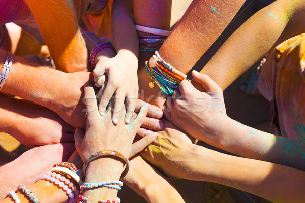 Friends putting their hands together in a sign of unity and team Stock photo © dashapetrenko