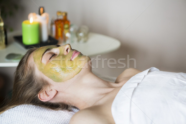Beautiful relaxed woman having clay face mask  Stock photo © dashapetrenko