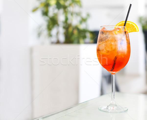 Orange cocktail with straw on white table Stock photo © dashapetrenko