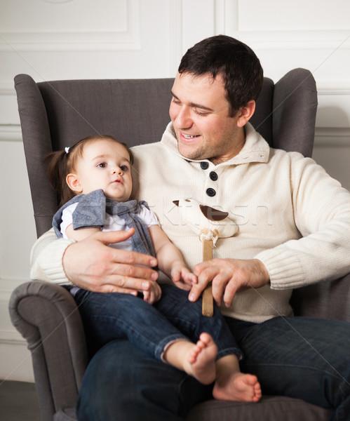 Boldog apa egyéves kislány bent mosolyog Stock fotó © dashapetrenko