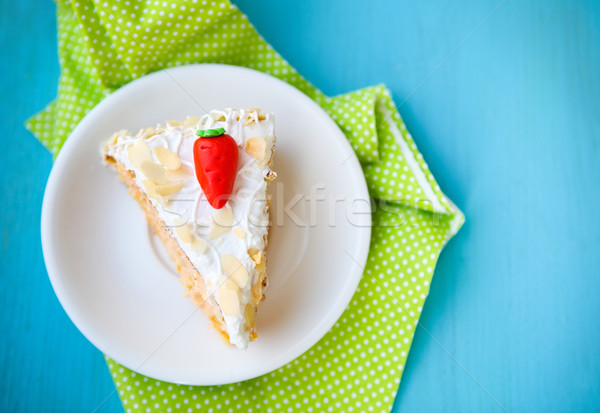 Piece of carrot cake with icing and little carrot Stock photo © dashapetrenko