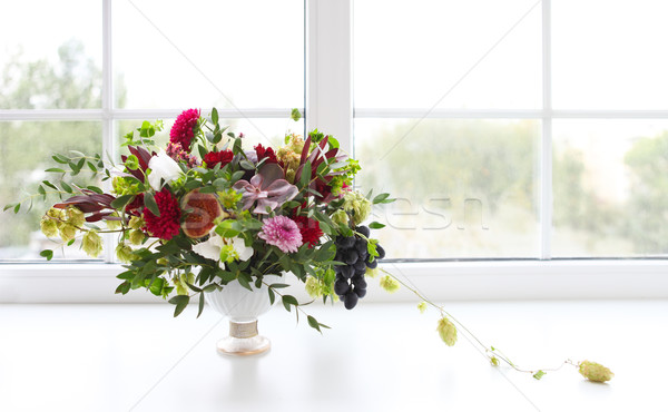 Unusual wedding composition with succulent flowers, grape, fig a Stock photo © dashapetrenko