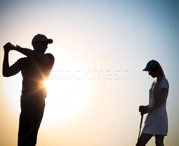 Masculina femenino puesta de sol jugando golf familia Foto stock © dashapetrenko