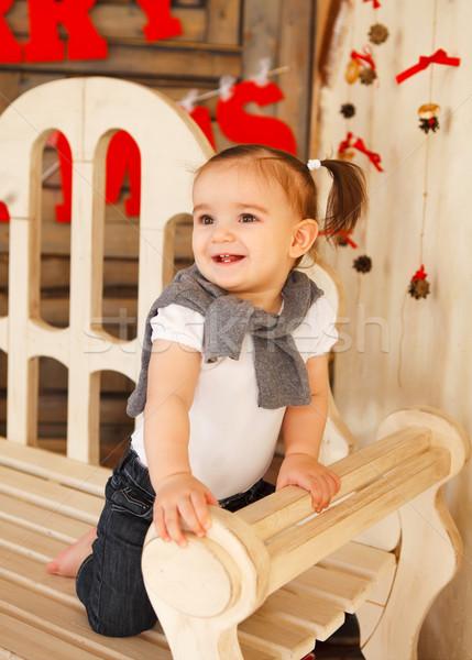 Mosolyog egyéves kislány bent portré baba Stock fotó © dashapetrenko