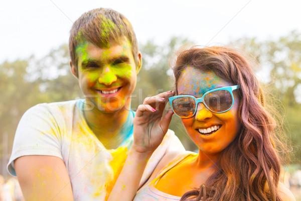 Portrait of happy couple on holi color festival Stock photo © dashapetrenko