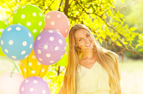 Happy woman with colored polka dots balloons Stock photo © dashapetrenko
