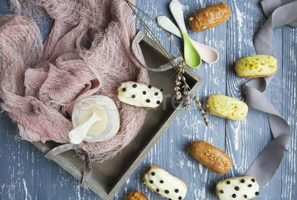 Eclairs with chocolate and whipped cream on dark background Stock photo © dashapetrenko
