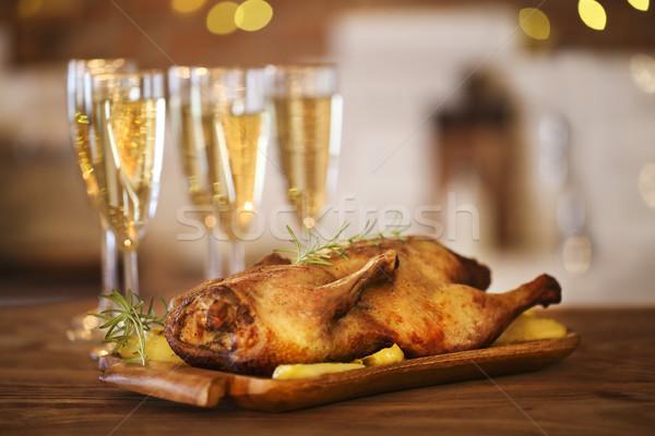 Christmas dinner with roast duck and champagne Stock photo © dashapetrenko