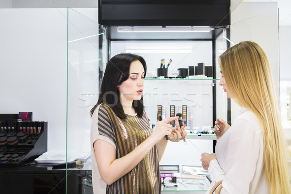 Young pretty woman and beauty consultant in shop Stock photo © dashapetrenko