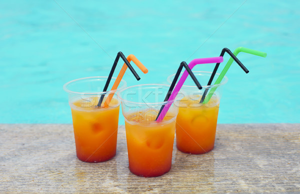 Glasses of tropical cocktail on poolside Stock photo © dashapetrenko