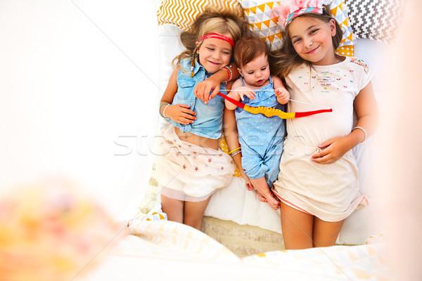 Three cute girl playing together Stock photo © dashapetrenko