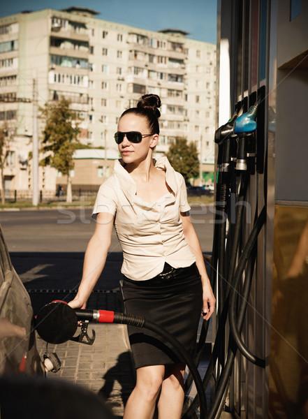 Young beautiful smiling woman fills petrol car Stock photo © dashapetrenko