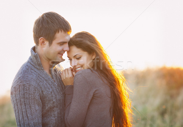 Portrait of young happy couple laughing in a cold day by the aut Stock photo © dashapetrenko