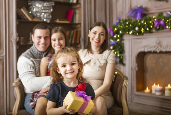 Stock photo: Stylish family celebrating christmas in room over christmas tree