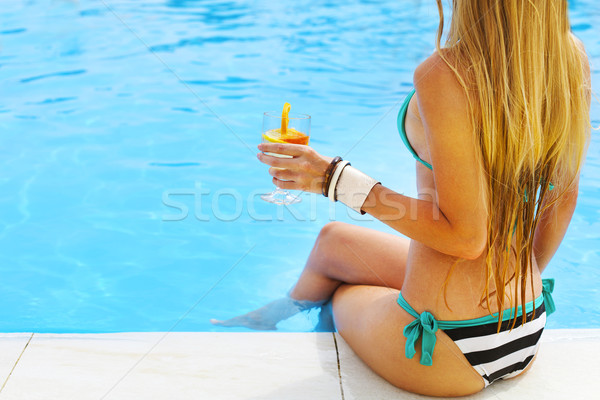 Pretty blond woman enjoying cocktail near the swimming pool Stock photo © dashapetrenko