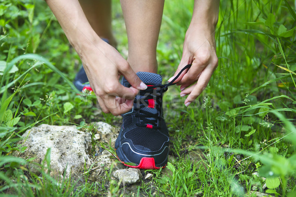 Athlete girl trying running shoes getting ready for jogging Stock photo © dashapetrenko