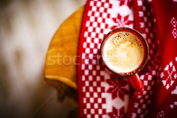 Christmas red and white background with mug of coffee Stock photo © dashapetrenko