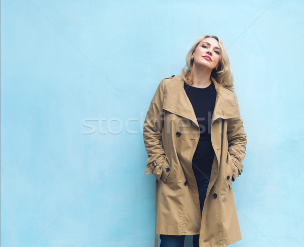 Middle age women near blue wall. Happiness concept. Stock photo © dashapetrenko