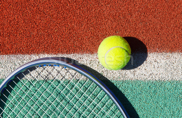 Close up of tennis racquet and ball on the tennis court Stock photo © dashapetrenko