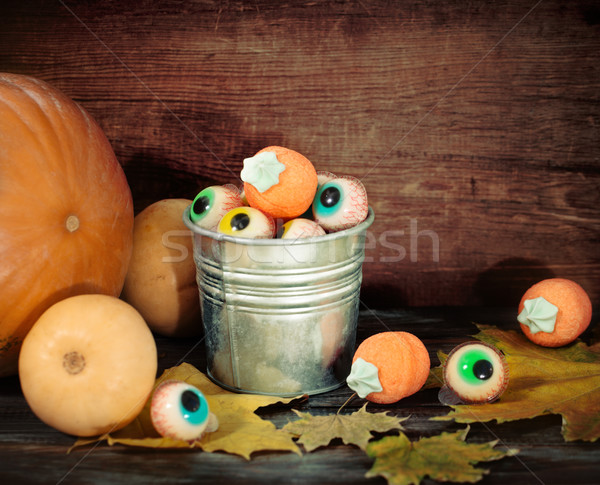 Halloween sweets, autumn leaves and pumpkins  Stock photo © dashapetrenko