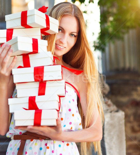 Gift boxes in the hands of young blond woman Stock photo © dashapetrenko
