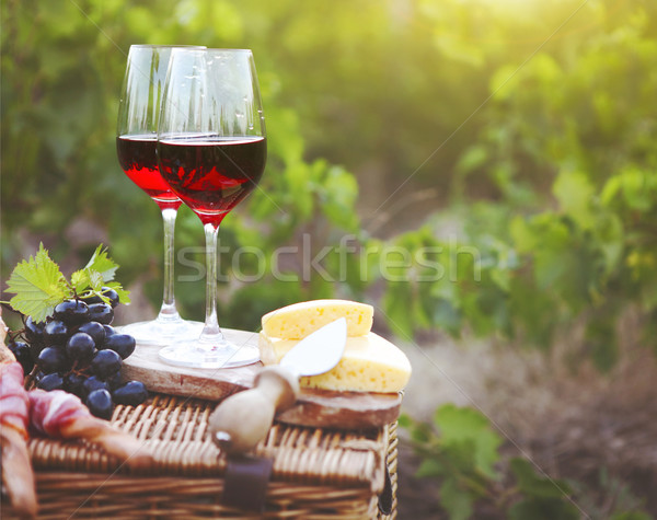 Two glasses of red wine with bread, meat, cheese on the vineyard Stock photo © dashapetrenko