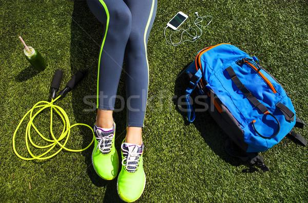 Sporty woman sitting on the green grass Stock photo © dashapetrenko