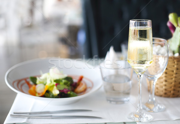 Dinner with sea food salad and champagne Stock photo © dashapetrenko